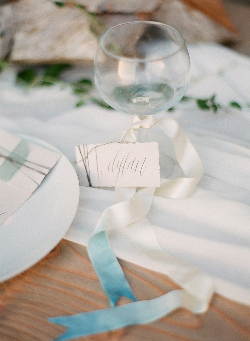 calligraphed escort cards by Gracelineart.com and indigo dip-dyed ribbons at this coastal tablescape at this wedding on the coast in oregon coast photographed by Destination Wedding Photographer, Lexia Frank - a film photographer in portland oregon. TOP DESTINATION WEDDING PHOTOGRAPHY, OREGON COAST WEDDING, WWW DOT LEXIA FRANK DOT COM