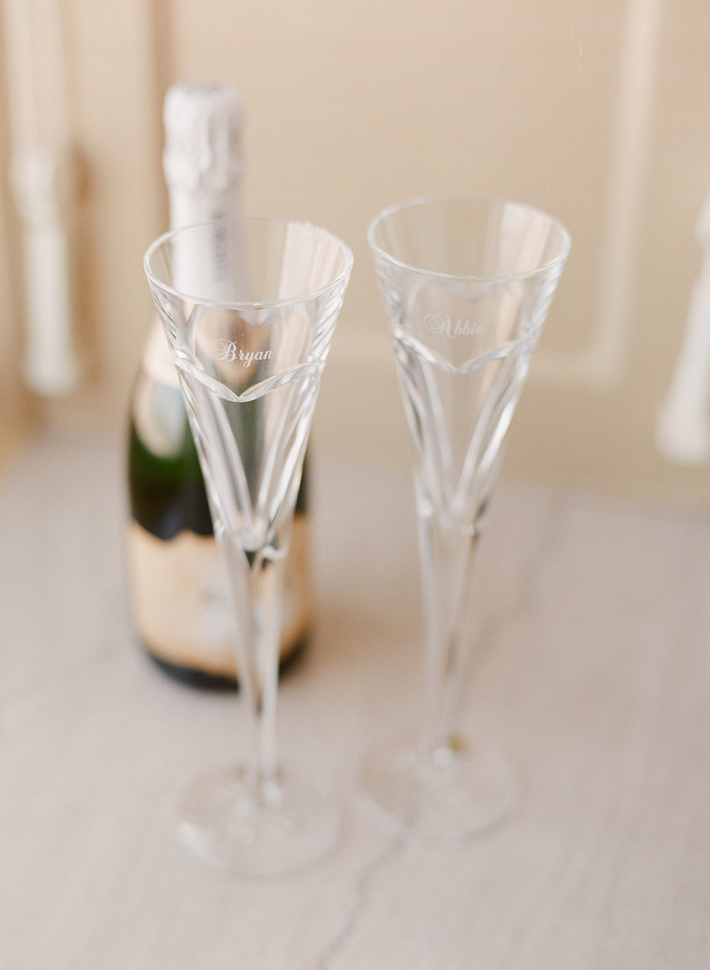 top destination wedding photographer lexia frank photographs the wedding of Green Bay Packer Bryan Bulaga and the custom crystal champagne glasses they used for their first toast, photographed on film, film photographer for weddings