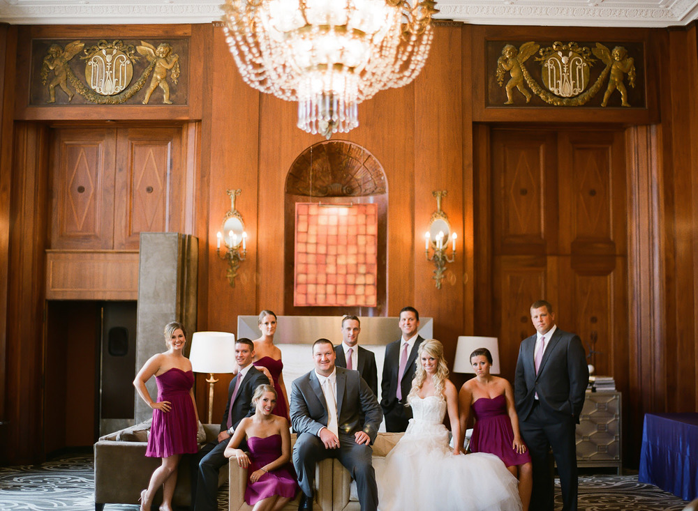 destination wedding photographer Lexia Frank photographs Pro Athlete Bryan Bulaga's wedding at the Hilton City Center in Downtown Milwaukee wedding photographer. large wedding party poses