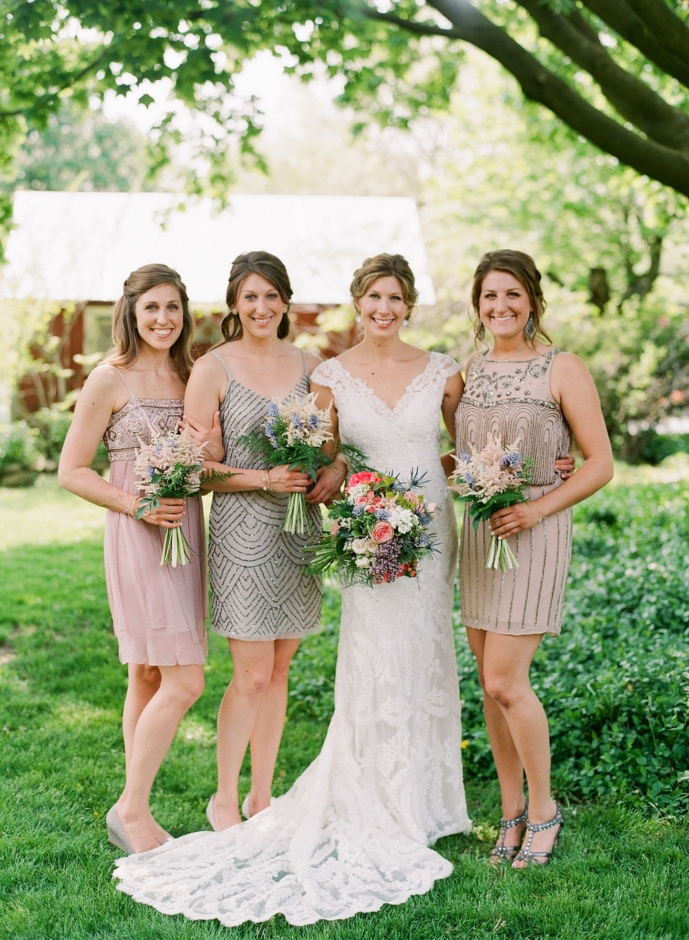 art deco nude bridesmaid dresses look great on the bridesmaids at this springtime wedding at Northwind Perennial Gardens - a beautiful wisconsin wedding venues - while Destination Wedding photographer Lexia Frank photographs this wedding on film