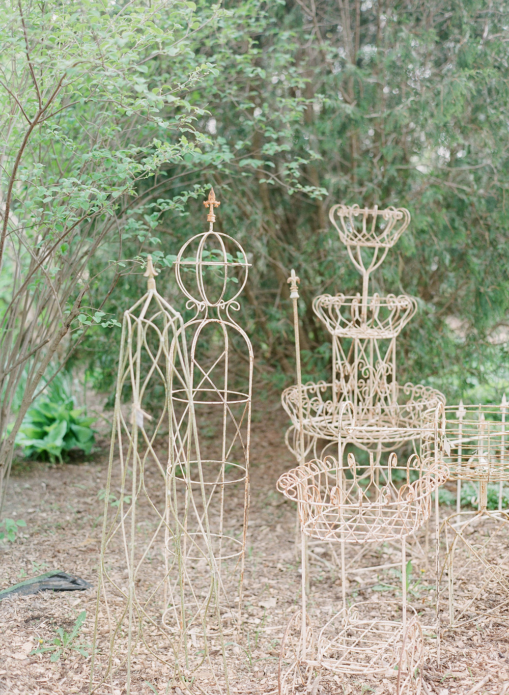 wrought iron garden items at this  springtime wedding at Northwind Perennial Garden - a beautiful wisconsin wedding venue - while Destination wedding photographer Lexia Frank Photographs this wedding on film
