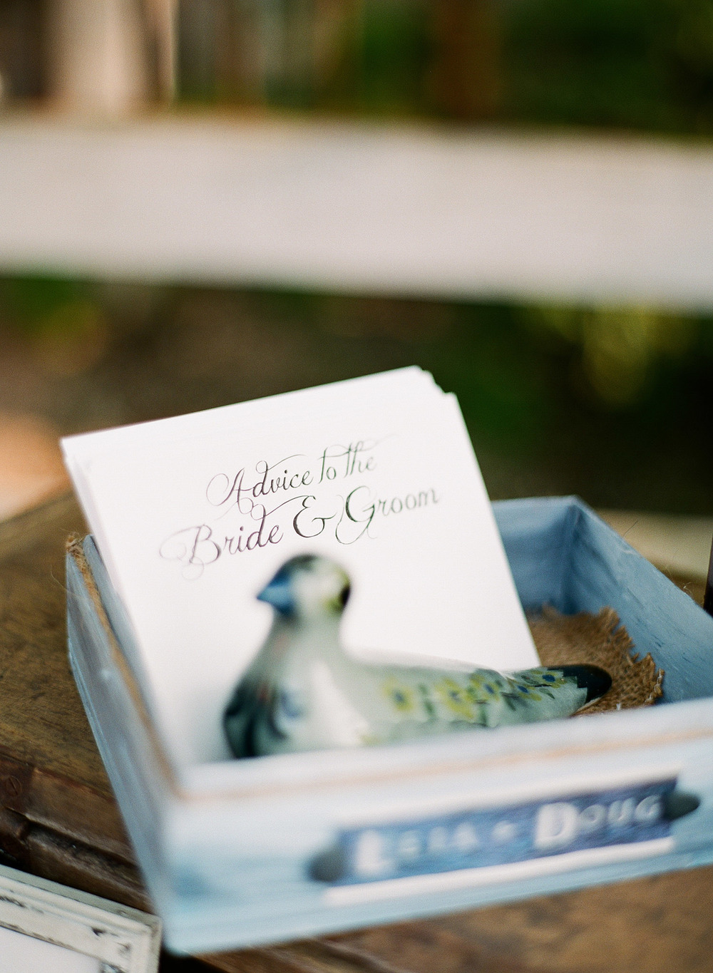 this unique guestbook idea is hand-written by a calligrapher for this springtime wedding at Northwind Perennial gardens - a wisconsin wedding venue - as a film wedding photographer Lexia Frank photographs this destination wedding on film