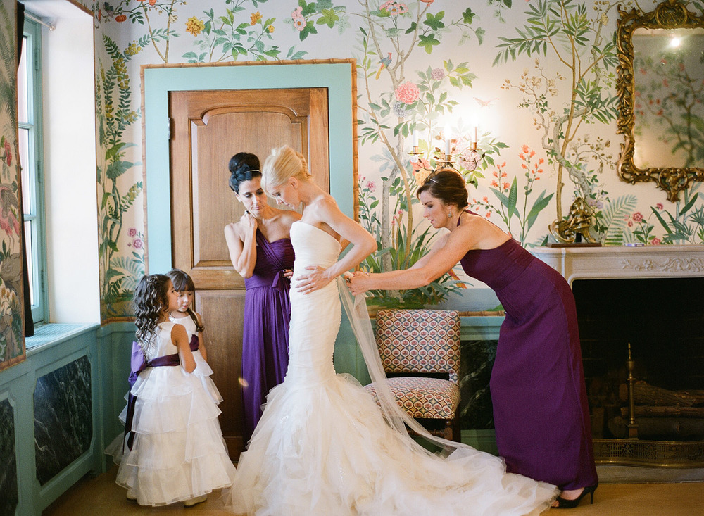 the bride gets ready with her bridesmaids and flower girls at this Italian Villa wedding at the Villa Terrace wedding where Destination Wedding Photographer, Lexia frank, photographs the wedding entirely on film