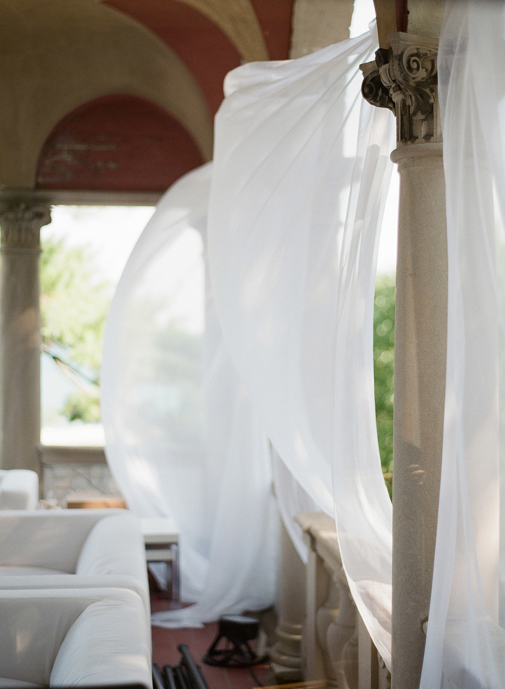 wind blows through silk at this Italian Destination Wedding at the Villa Terrace - a favorite wedding venue by Destination wedding photographer Lexia Frank who is a film photographer for weddings