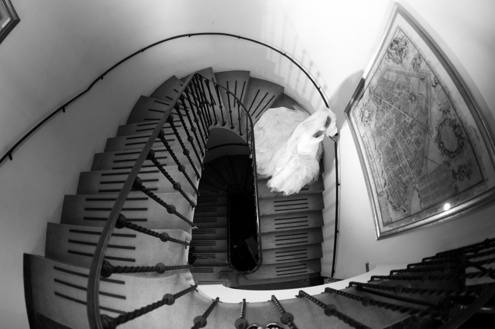 the bride walks down the staircase at the Villa Terrace- an italian villa that is a favorite wedding venue of Destination WEdding Photographer, Lexia Frank, who is a film photographer for weddings
