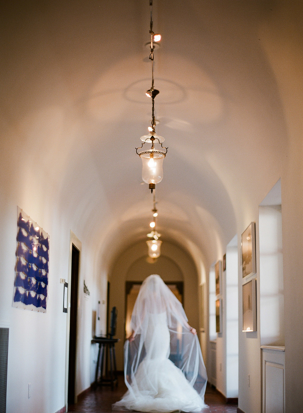the bride walks down the hall to her Italian Destination Wedding at the Villa Terrace - a favorite wedding venue of International Destination Wedding photographer, Lexia Frank, who is a film photographer for luxury weddings worldwide.