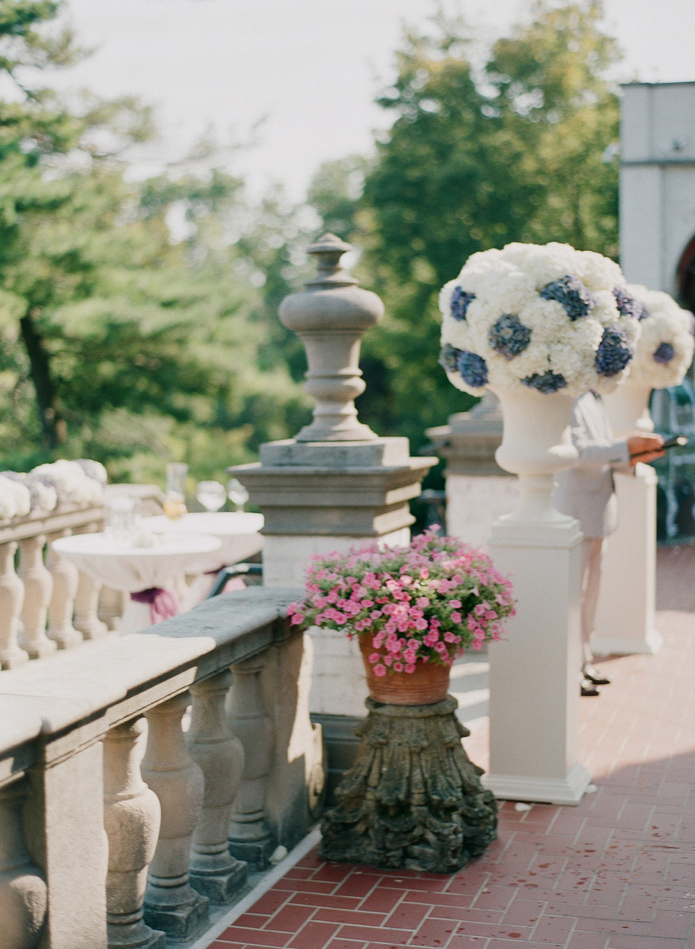 floral arrangements of vintage purple hydrangeas at the Italian Destination Wedding at the Villa Terrace - a favorite wedding venue of international wedding photographer, Lexia Frank, who is a film photographer for luxury weddings worldwide.