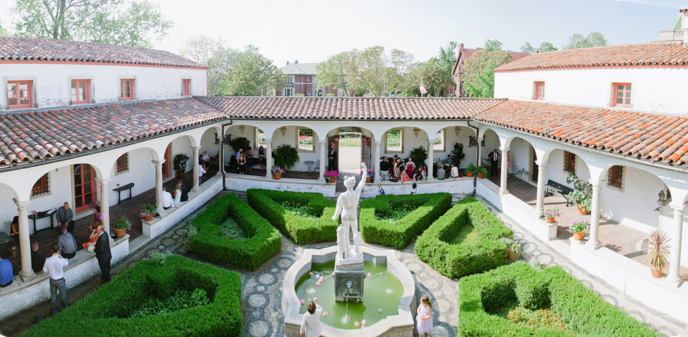 panoramic image of the italian destination wedding at the Villa Terrace in milwaukee by International Destination Wedding photographer Lexia Frank who is a film photographer for luxury weddings