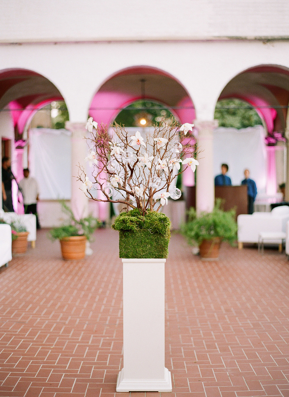 moss floral arrangements at the Italian Destination Wedding at the Villa Terrace - a favorite wedding venue of Destination wedding photographer, lexia frank, who is a film photographer for luxury weddings