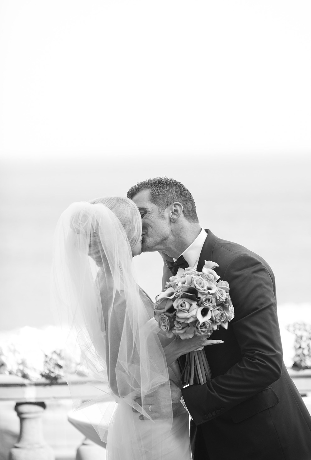 the couples has their first kiss at the destination Italian wedding at the Villa Terrace - a favorite wedding venue of destination wedding photographer lexia frank, who is a film photographer for luxury weddings