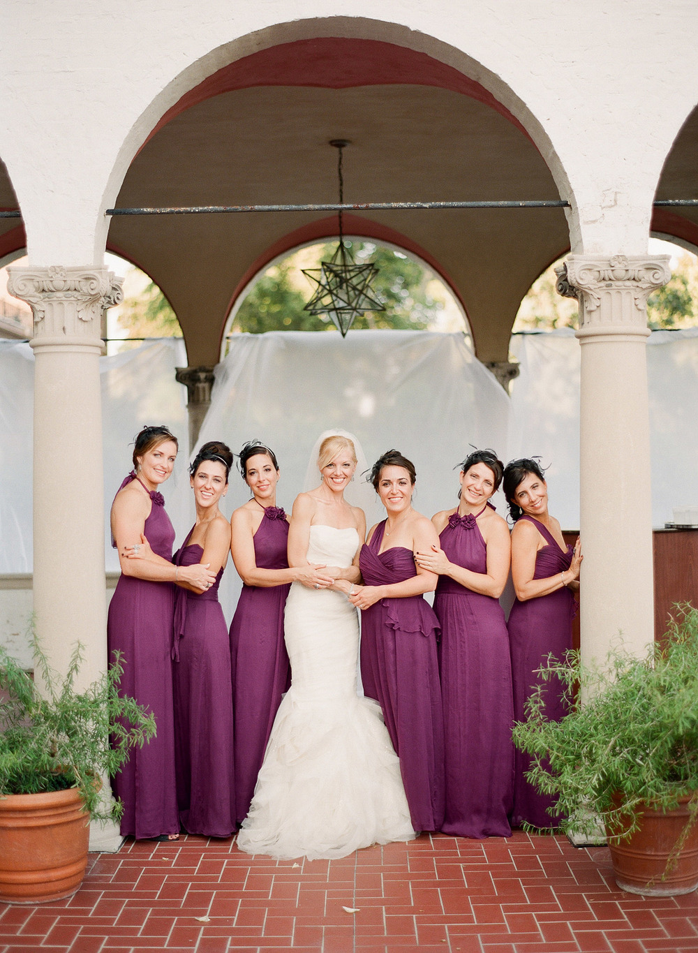 bride poses with the bridesmaids at her destination italian wedding at the Villa Terrace where Destination wedding photographer LExia Frank loves to shoot film for her luxury weddings