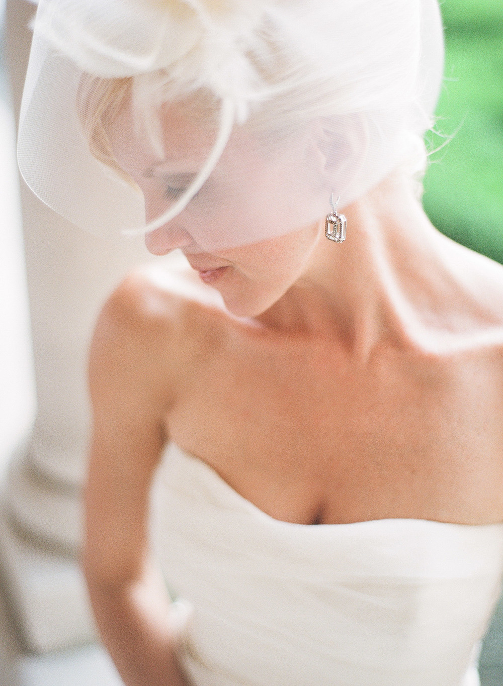 wedding hat on a bride at an italian wedding at The Villa Terrace photographed by Lexia Frank photography, film photographer who shoots luxury destination weddings