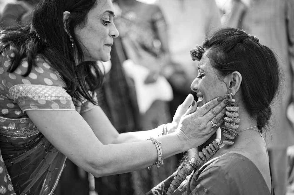 Auntie touches Indian Bride's face during this Indian Wedding in Florida captured by Destination Wedding Photographer Lexia Frank, who is a film photographer and indian wedding photographer