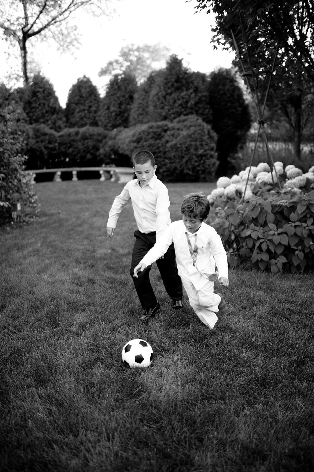 boys play soccer at the cocktail hour during this italian destination wedding at the Italian Villa, The villa Terrace, a beautiful italian wedding venue. Destination wedding photographer Lexia Frank photographs this wedding on film