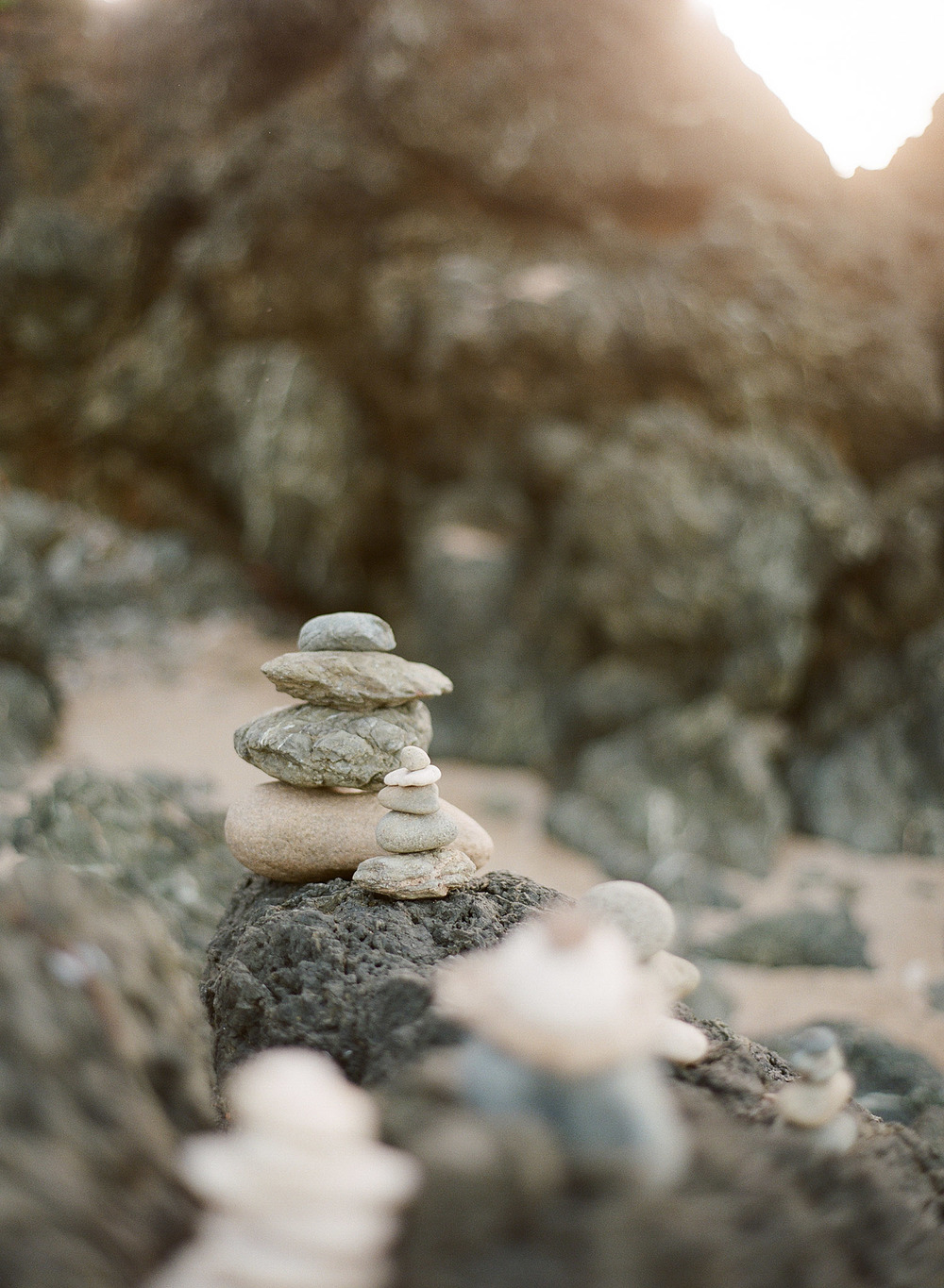 stones are stacked on the beach at Vieques Island Puerto rico at this modern destination wedding at the W hotel on Vieques island puerto rico- while Destination wedding photographer Lexia Frank photographs this wedding on film