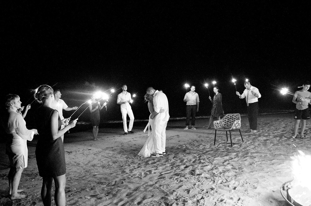 the couple shares a first dance on the beach surrounded by sparklers and a bonfire at the modern vieques island wedding at the w hotel in puerto rico photographed by destination wedding photographer Lexia Frank - a film photographer for weddings