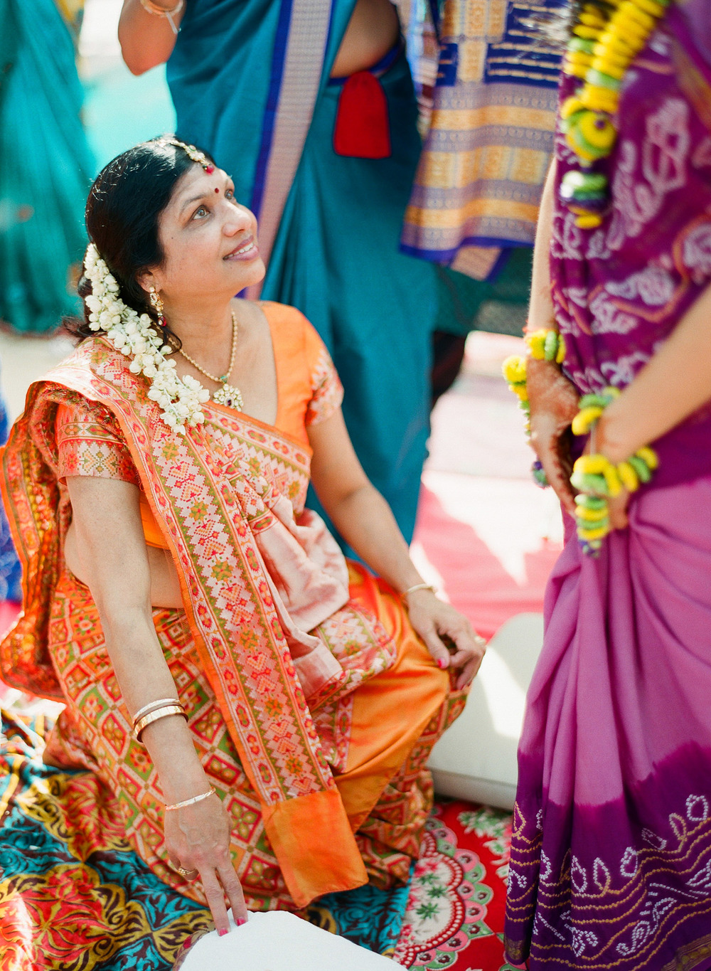 aunties help indian bride during her hindu pithi ceremony in palm coast florida while destination wedding photographer Lexia Frank - rated best indian wedding photographer - photographs this luxury indian wedding on film because she is a film photographer in florida for luxury weddings