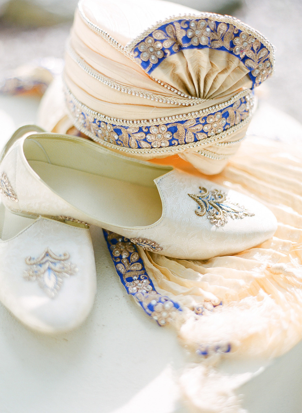 grooms attire for this hindu wedding ,   mojri   turban  Sherwani and a chudidar, while Destination wedding photographer Lexia Frank - a top indian wedding photographer for luxury indian weddings- photographs this luxury indian wedding in florida on film as she prefers the soft skin tones and vibrant colors for indian weddings in india and worldwide.  manish malhotra suneet varna
