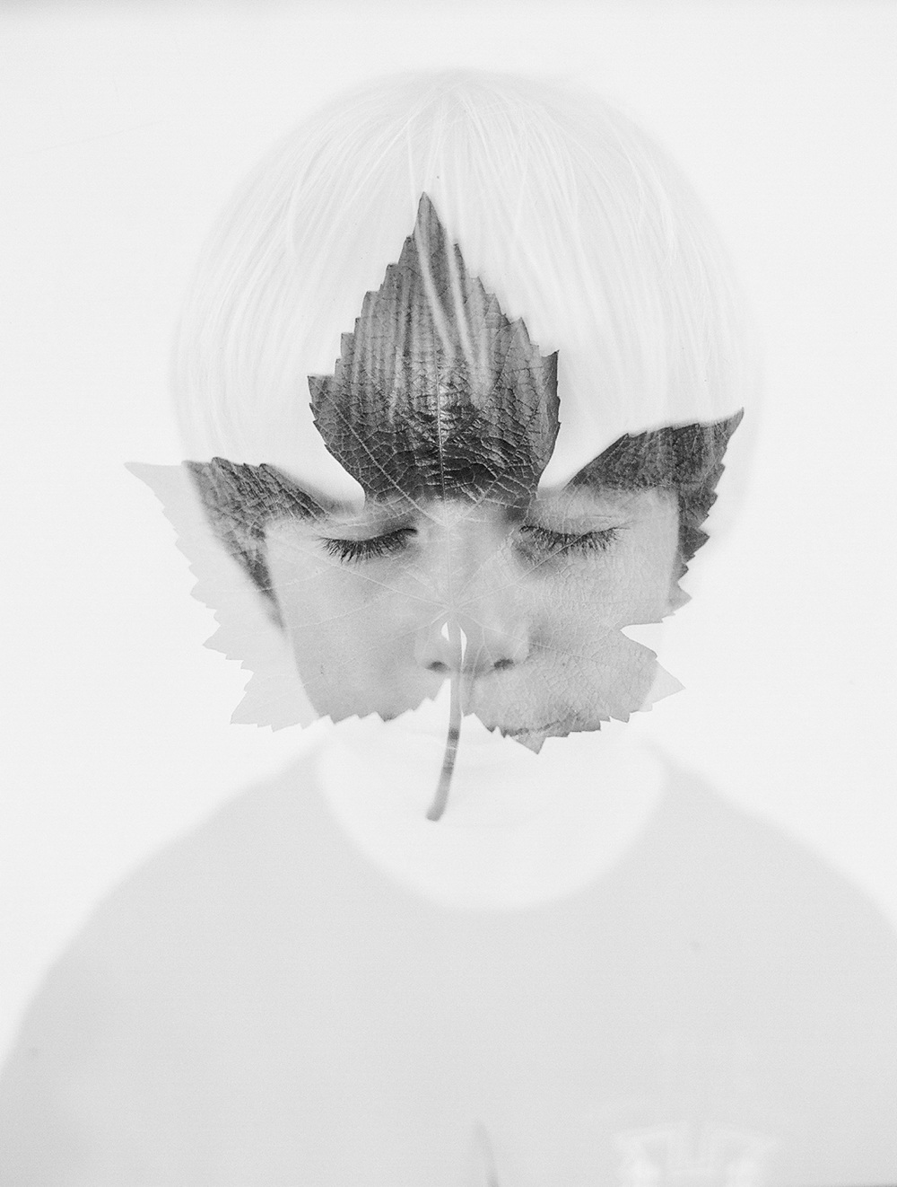 portland oregon film photographer Lexia Frank, photographs her son in black and white film double exposed with a leaf for a fine art image of her child