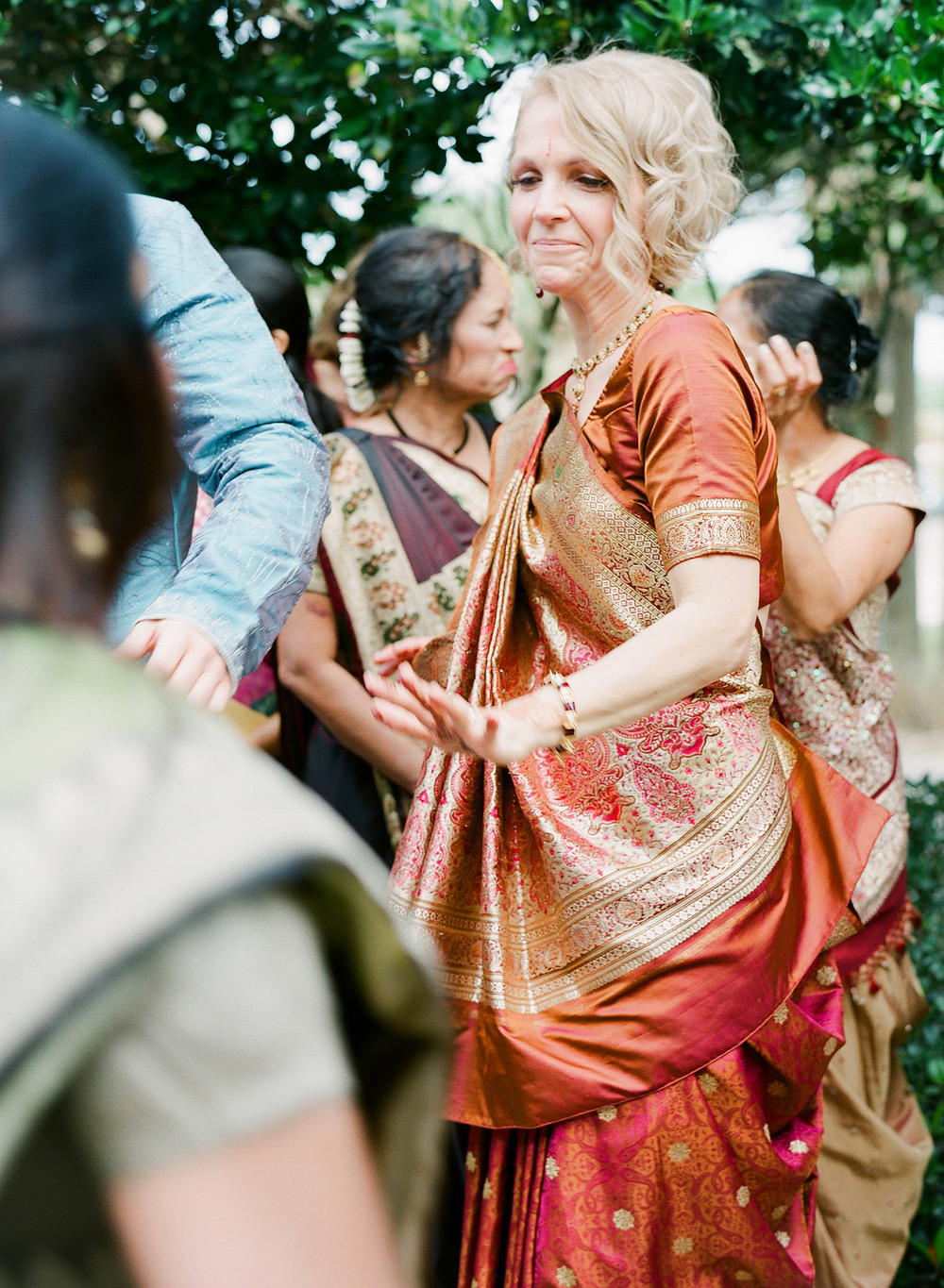 The groom's mother dances during this Indian Wedding in Florida photographed by Destination Wedding Photographer, LExia Frank - a top indian wedding photographer - who shoots film for luxury indian weddings preferring the soft skin tones and vibrant colors for indian weddings in india and worldwide
