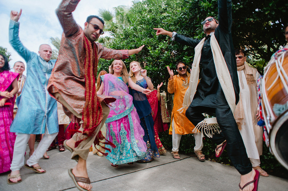 people dance at the parade at this Indian Wedding in Florida photographed by Destination Wedding Photographer, LExia Frank - a top indian wedding photographer - who shoots film for luxury indian weddings preferring the soft skin tones and vibrant colors for indian weddings in india and worldwide