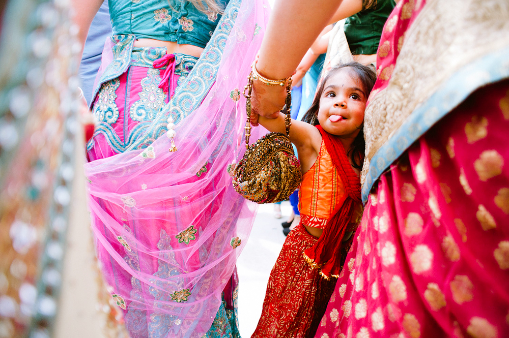 little girl dances during the parade at this Indian Wedding in Florida photographed by Destination Wedding Photographer, LExia Frank - a top indian wedding photographer - who shoots film for luxury indian weddings preferring the soft skin tones and vibrant colors for indian weddings in india and worldwide