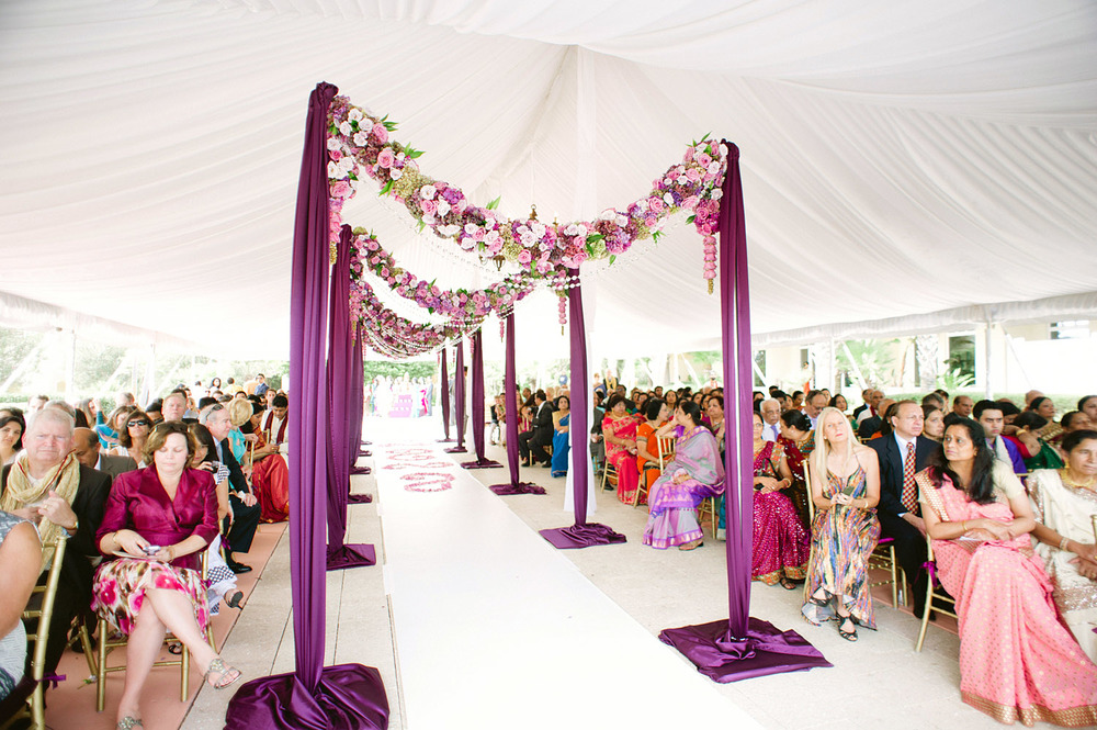 the isle was decorated with boughs of flowers leading up to the mandap at this Indian Wedding in Florida photographed by Destination Wedding Photographer, LExia Frank - a top indian wedding photographer - who shoots film for luxury indian weddings preferring the soft skin tones and vibrant colors for indian weddings in india and worldwide