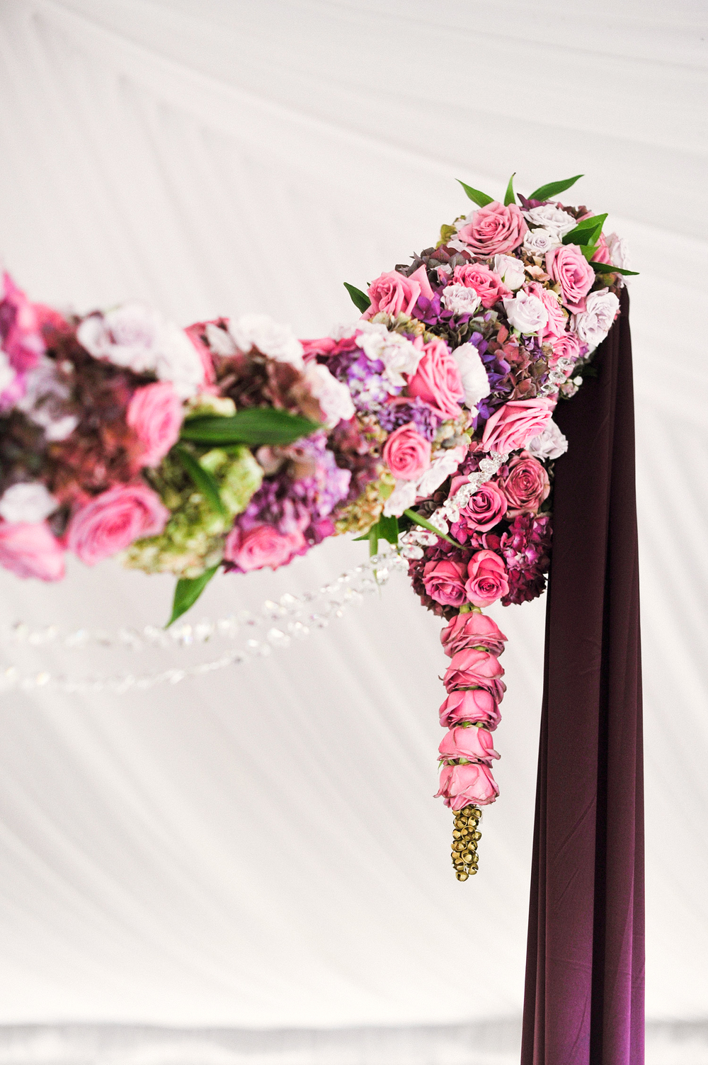 detail of the flower mandap with indian ankle bells for this Indian Wedding in Florida photographed by Destination Wedding Photographer, LExia Frank - a top indian wedding photographer - who shoots film for luxury indian weddings preferring the soft skin tones and vibrant colors for indian weddings in india and worldwide