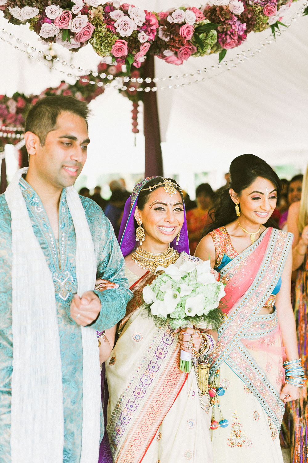 indian bride is escorted down the aisle by her brother and sister for this Indian Wedding in Florida photographed by Destination Wedding Photographer, LExia Frank - a top indian wedding photographer - who shoots film for luxury indian weddings preferring the soft skin tones and vibrant colors for indian weddings in india and worldwide