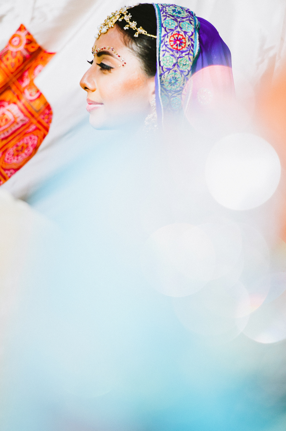 bride waits at her hindu ceremony in florida at this Indian Wedding in Florida photographed by Destination Wedding Photographer, LExia Frank - a top indian wedding photographer - who shoots film for luxury indian weddings preferring the soft skin tones and vibrant colors for indian weddings in india and worldwide