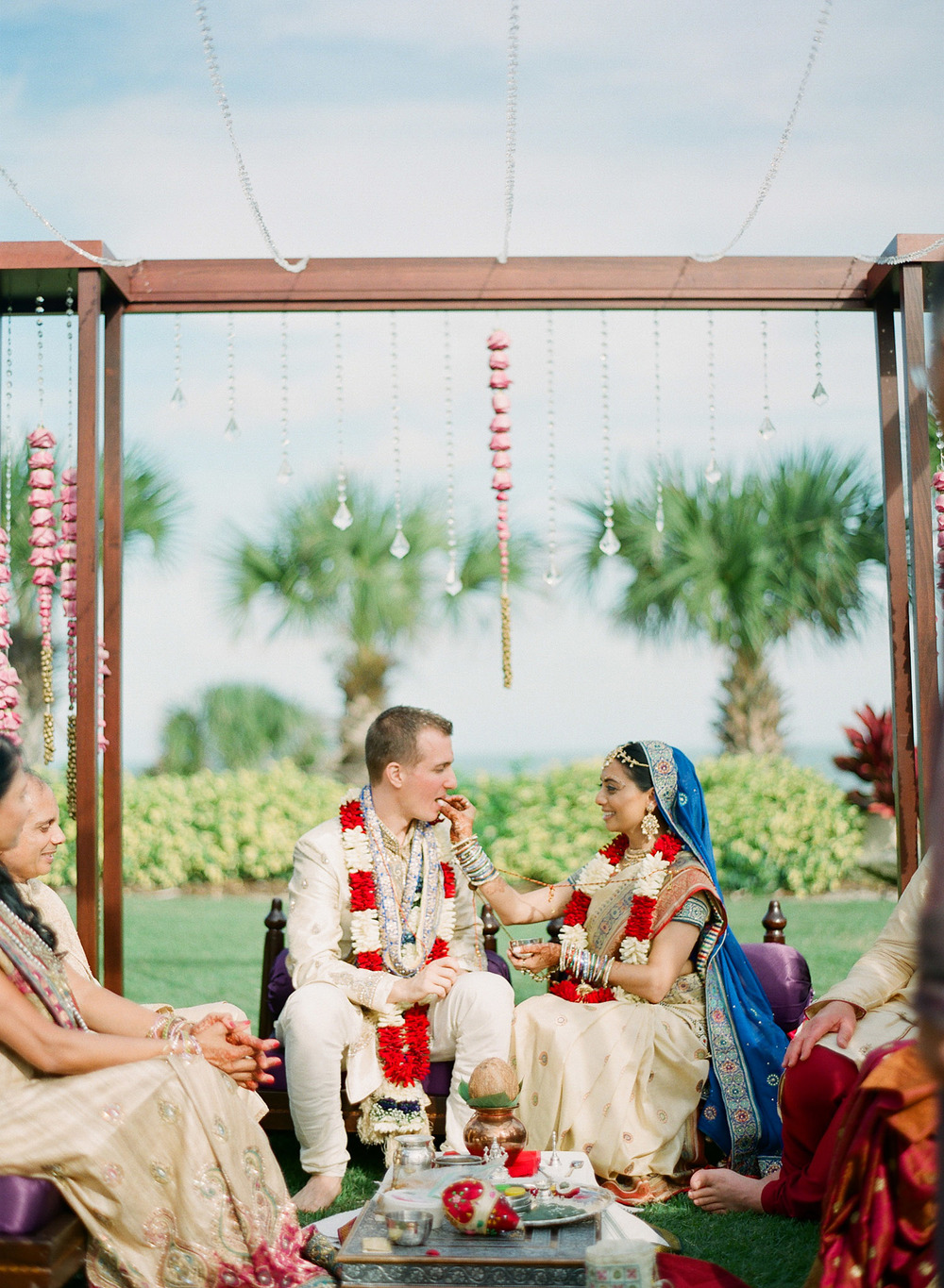 bride and groom at the hindu wedding in florida at the Indian Wedding in Florida photographed by Destination Wedding Photographer, LExia Frank - a top indian wedding photographer - who shoots film for luxury indian weddings preferring the soft skin tones and vibrant colors for indian weddings in india and worldwide
