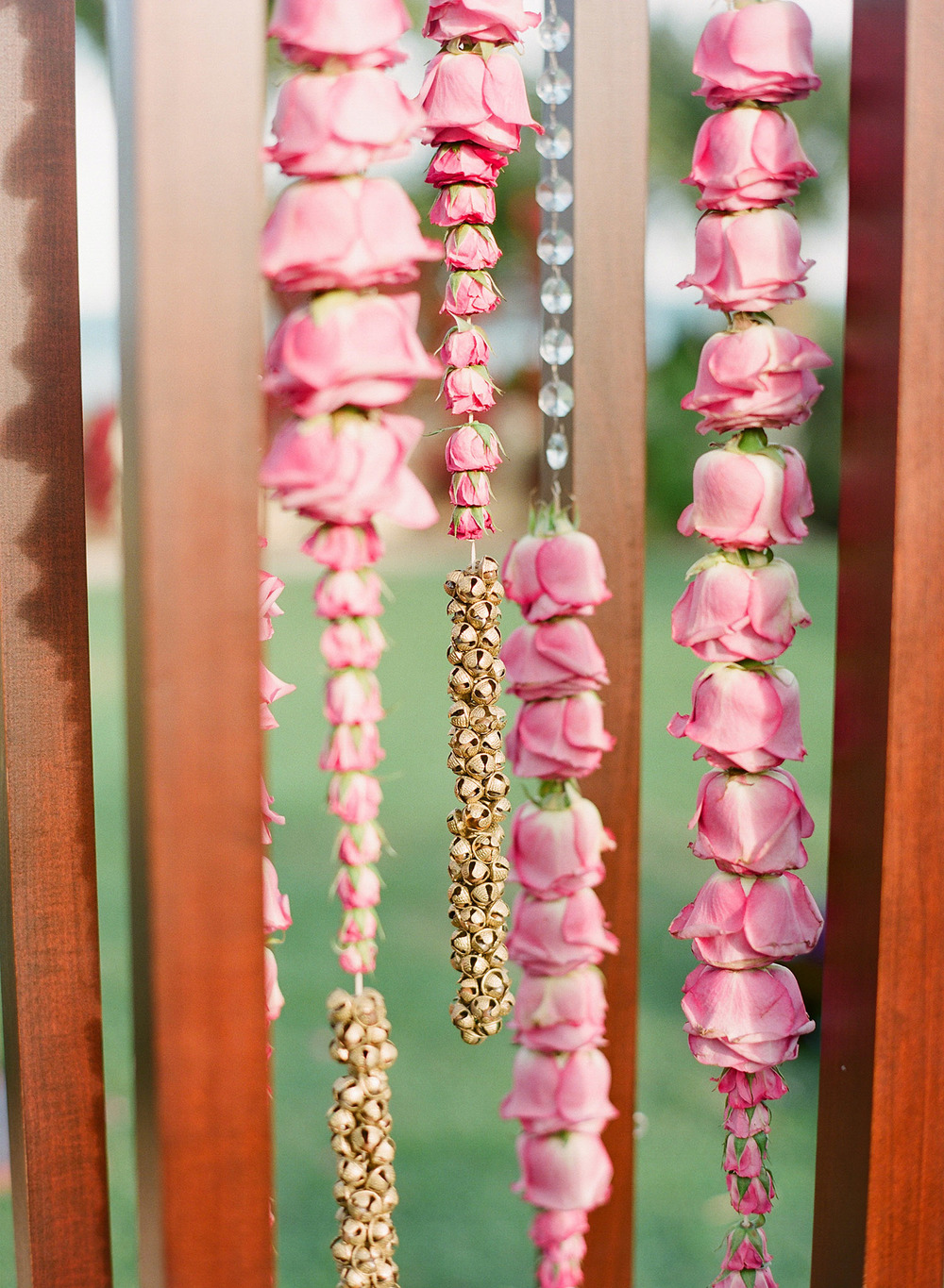 detail of the mandap with cascading flowers and indian ankle bells traditionally used for dancing at this Indian Wedding in Florida photographed by Destination Wedding Photographer, LExia Frank - a top indian wedding photographer - who shoots film for luxury indian weddings preferring the soft skin tones and vibrant colors for indian weddings in india and worldwide