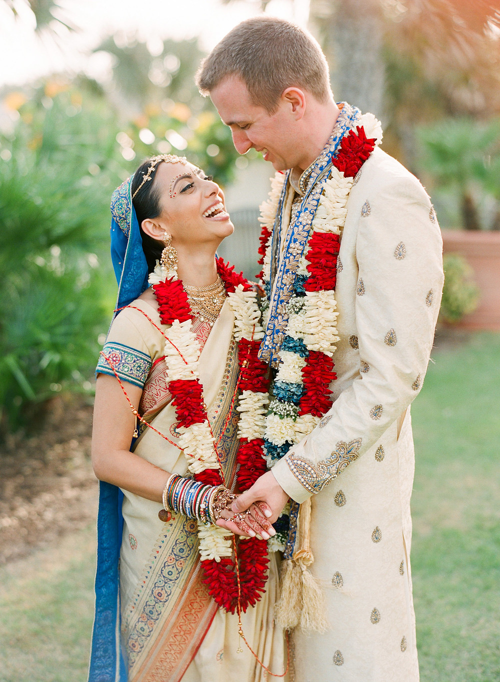 bride and groom after their hindu wedding ceremony at this Indian Wedding in Florida photographed by Destination Wedding Photographer, LExia Frank - a top indian wedding photographer - who shoots film for luxury indian weddings preferring the soft skin tones and vibrant colors for indian weddings in india and worldwide