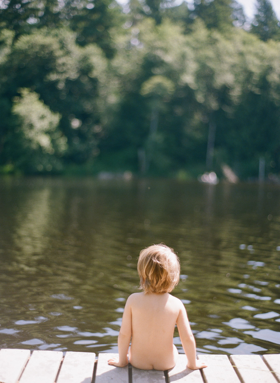 little boy sits on a dock in portland oregon during this lifestyle family session by Portland Oregon Lifestyle Photographer - LExia Frank - a film photographer in portland oregon