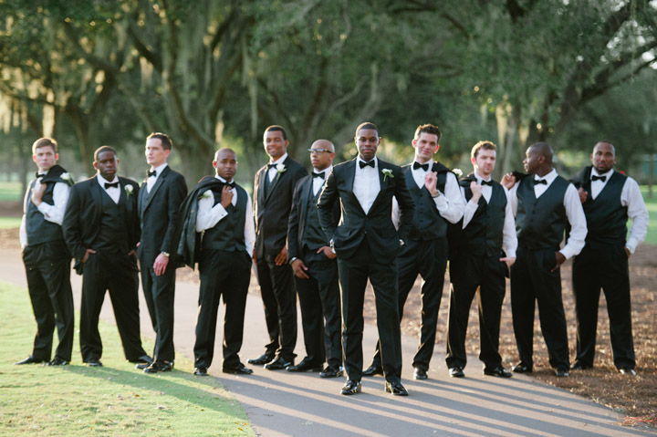 Destination Wedding Photographer Lexia Frank is a film photographer on the west coast specializing in luxury weddings and fine art film photography. In this article she writes a letter to the groom, and talks about the groom's role in photography. groom poses with his groomsmen in Tampa Florida wedding photographer www.lexiafrank.com