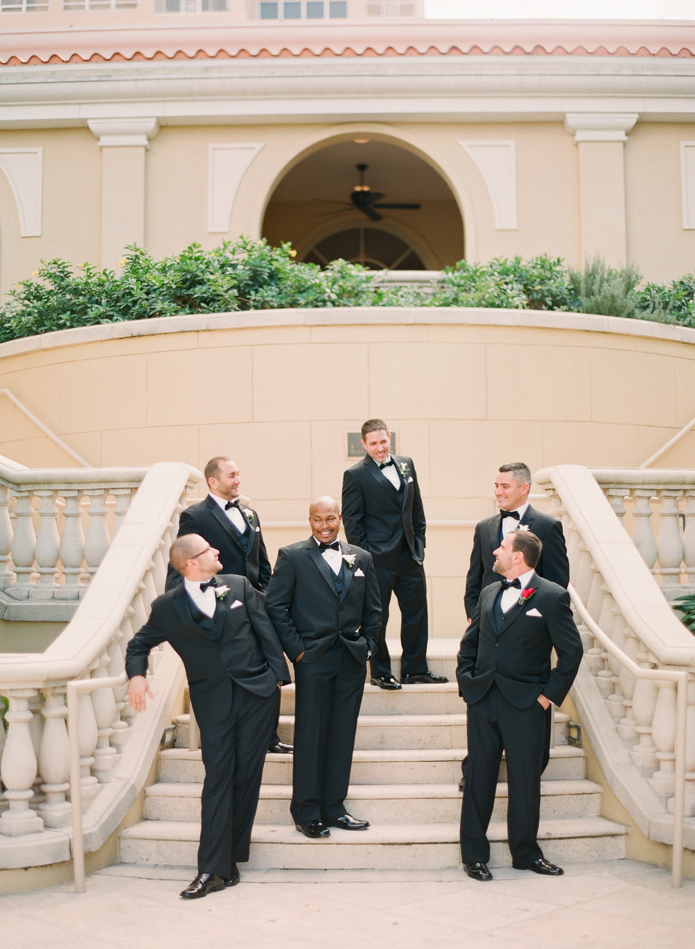 Destination Wedding Photographer Lexia Frank is a film photographer on the west coast specializing in luxury weddings and fine art film photography. In this article she writes a letter to the groom, and talks about the groom's role in photography. Groomsmen pose at the Ritz Carlton in Florida wedding www.lexiafrank.com