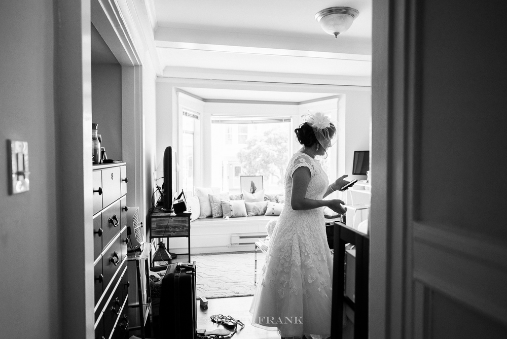 Destination Wedding Photographer Lexia Frank - a portland fine art film photographer- photographs a san francisco city hall wedding in san francisco as bride gets ready. www.lexiafrank.com
