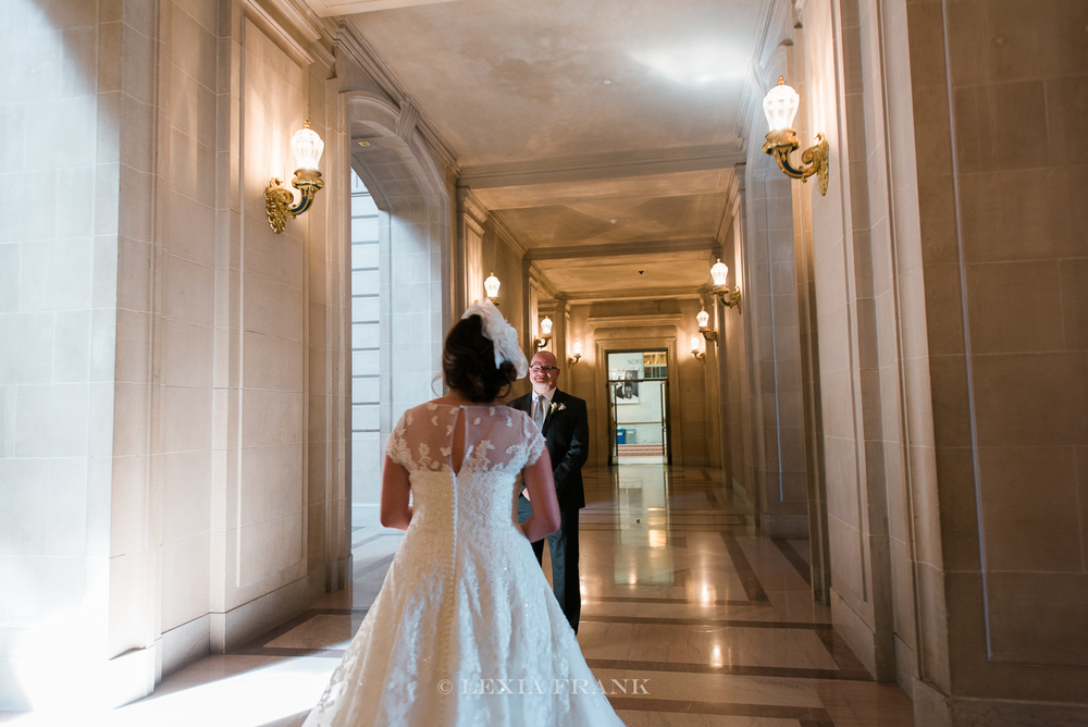 destination wedding photographer Lexia Frank - a portland oregon fine art film photographer - photographs this san francisco city hall wedding in sanfrancisco as bride and groom have their first look. www.lexiafrank.com