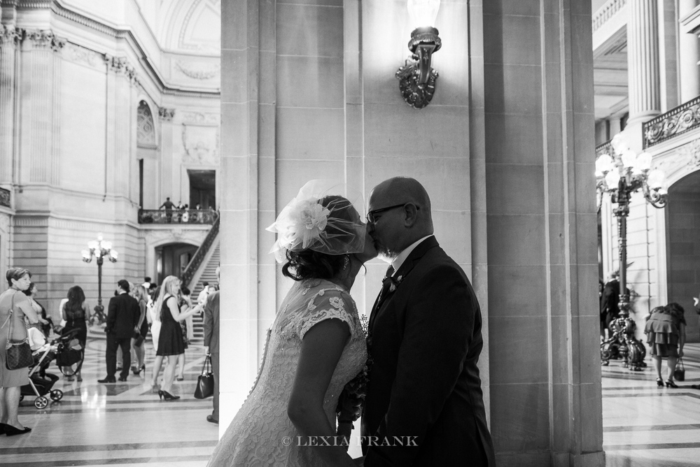 destination wedding photographer Lexia Frank - a portland oregon fine art film photographer - photographs this san francisco city hall wedding as bride and groom see each other the first time. www.lexiafrank.com