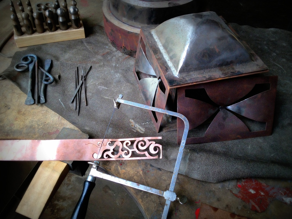 Using jewelers saws, blacksmithing and hand filing to create housewares And Artisan Pieces.