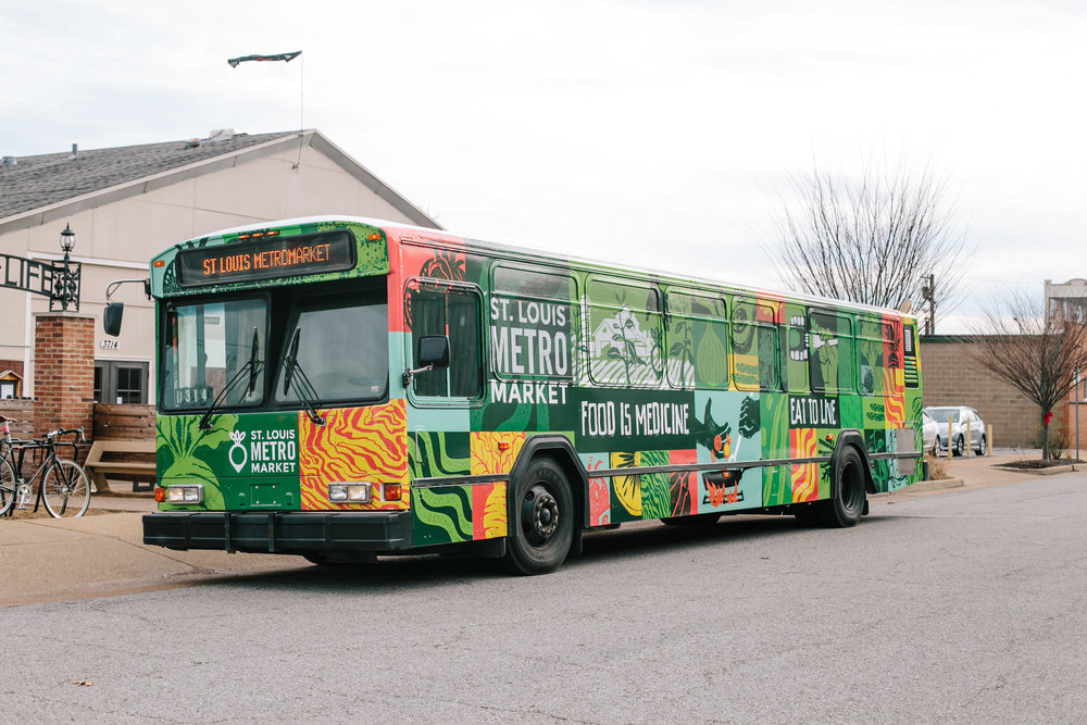 St. Louis based artist Noah MacMillan designed a mural for the exterior of the bus telling its story and purpose for the communities it serves.