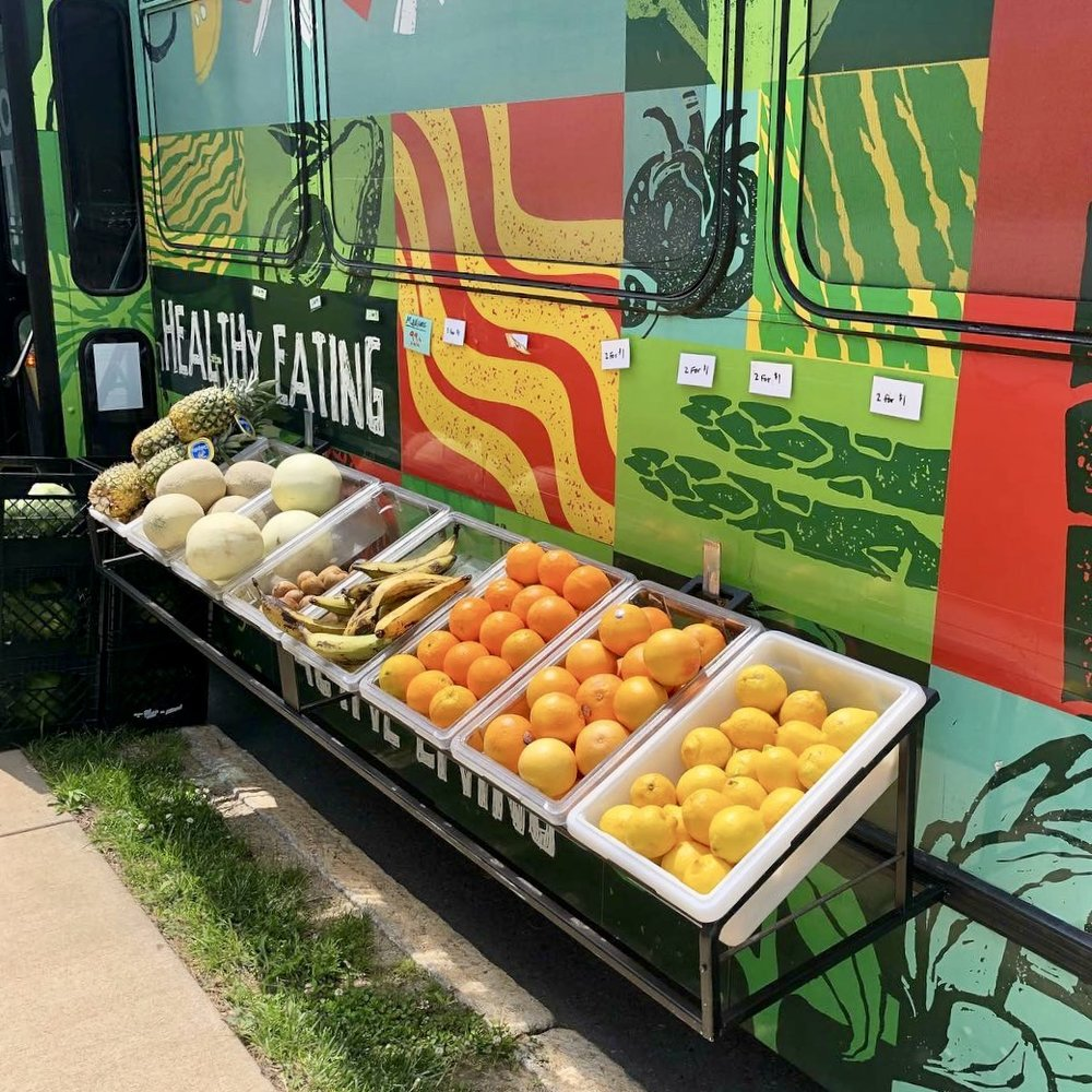 Removable produce bin racks bring the market to the outside of the bus.