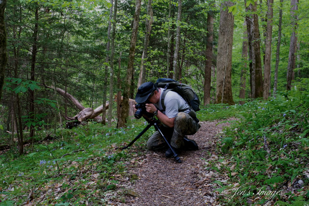 Jenny Davis' photo of husband Greg photographing wildflowers during the spring wildflower bloom at Yahoo Falls.