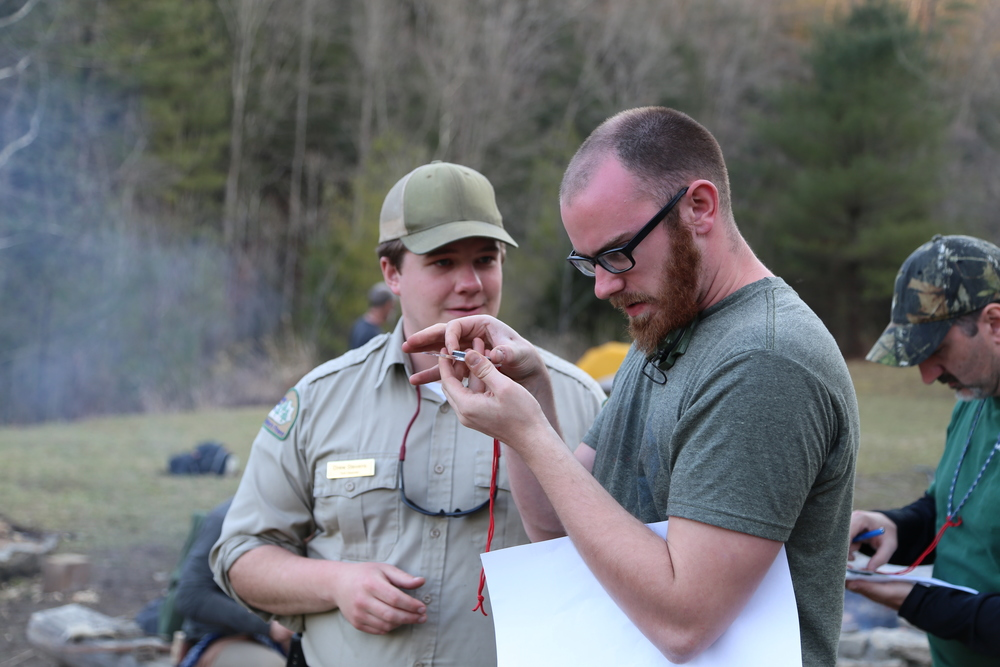 Park naturalist Drew Stevens teaching EKI Board Member Austin Yates compass navigation skills. Photo by Todd Nystrom.