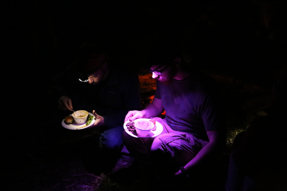 "Enjoying a hearty ""survival"" meal of venison burgoo, green beans, and biscuits around the campfire."
