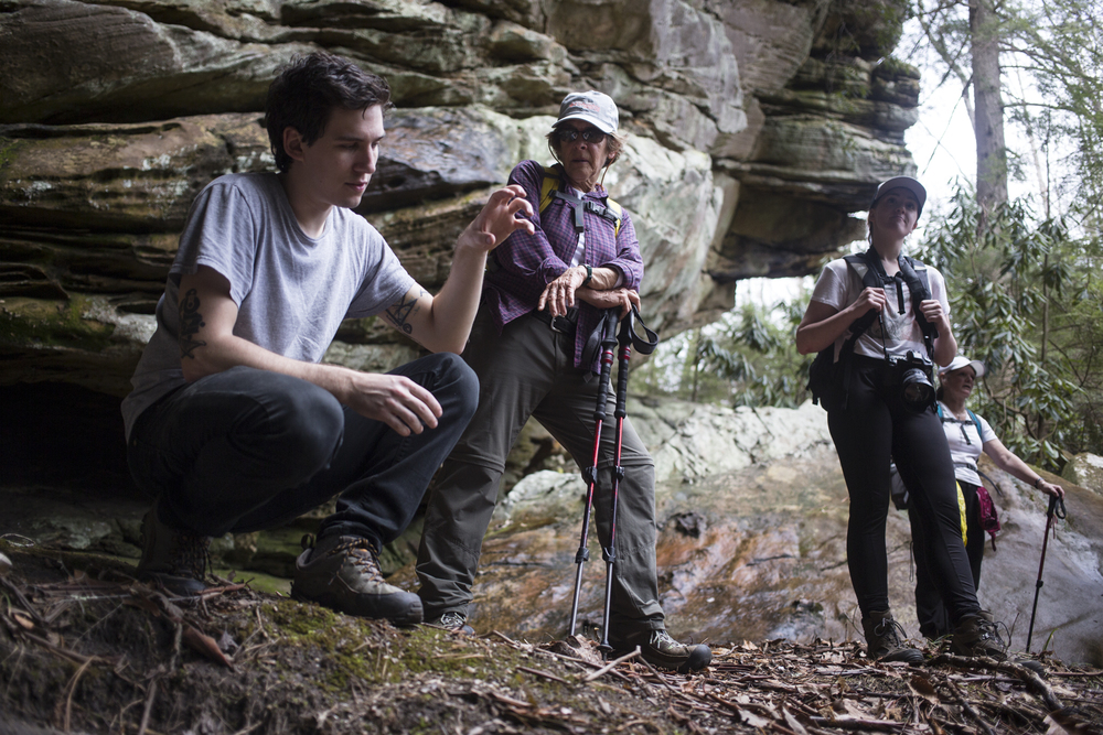 Telling a story during a group hike at Blanton Forest State Nature Preserve in Harlan County. Photo via Matt Herp