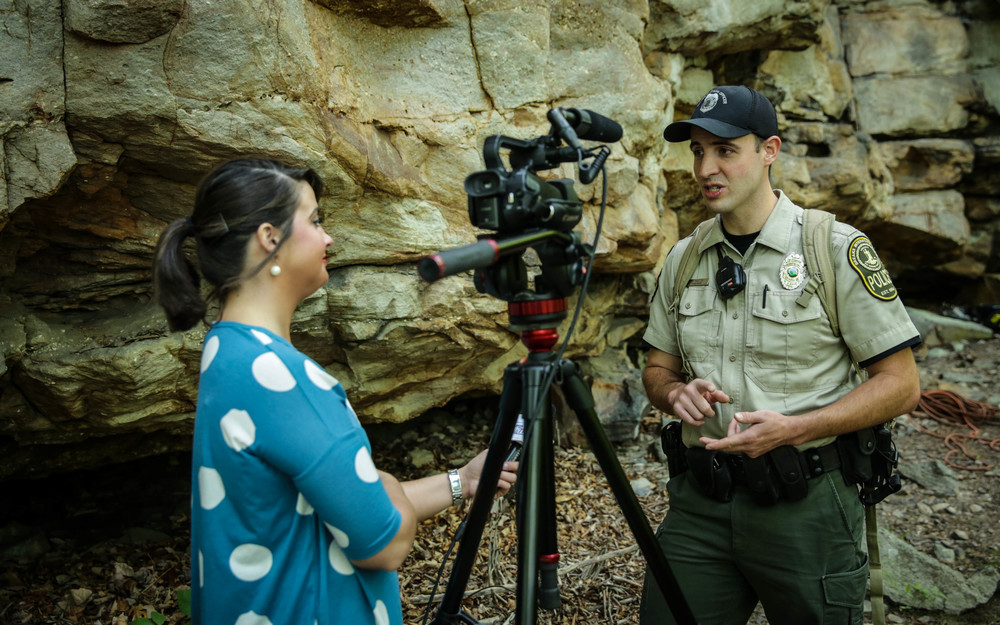 A reporter from Eastern Kentucky Broadcast -TV interviews Austin Bradley, Breaks Interstate Park on the inaugural day of sanctioned rock climbing at the 4,500 acre park shared between the states of Kentucky and Virginia.  Photo:  Gerry Seavo James