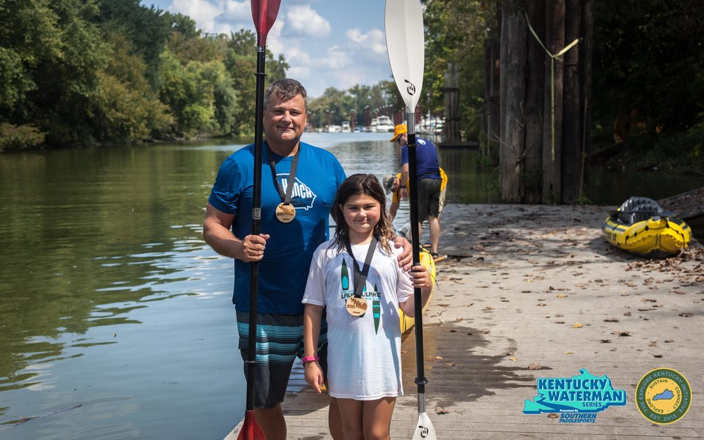 Joe & Emma-Kate Stibler at the finish line of the 7 mile race after finishing 1st place in the tandem kayak division. Photo by Gerry James