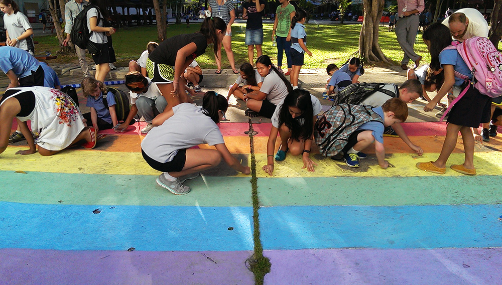 Teachers and students arrived at NIST International School on 15 May to find a #schoolrainbow in progress in the main square. What else to do but join in? Hundreds of hands made light work and lots of fun too.  ©UNAIDS/UNESCO/H.Nhan