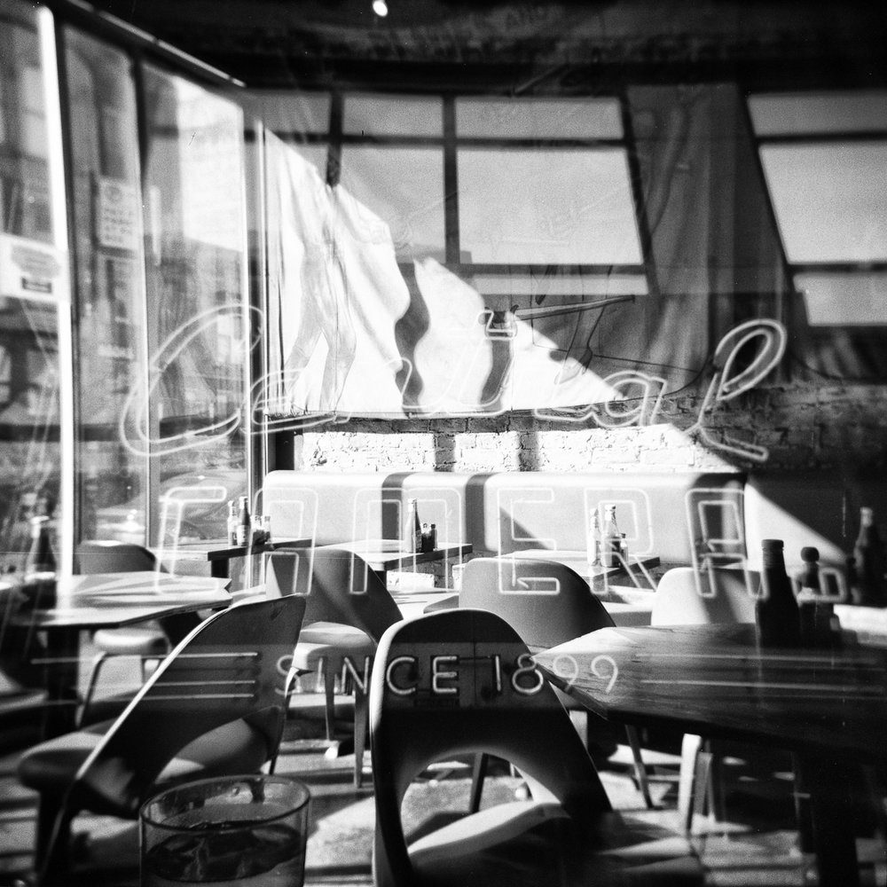 "Coffee & Cameras  12""x12"" Black & White C-Print - $200 - Edition of 25 24""x24"" Black & White C-Print - $500 - Edition of 20"